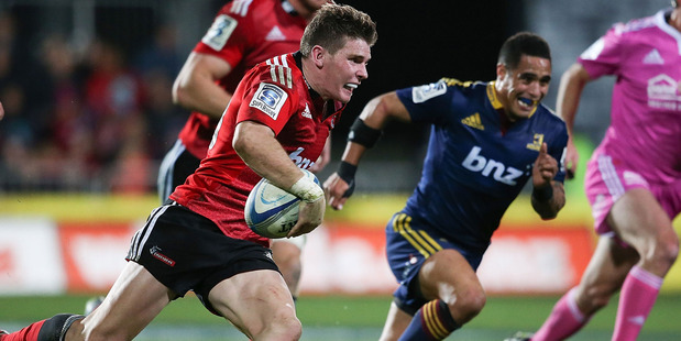 Colin Slade makes a break during the Crusaders' victory over the Highlanders. Photo / Getty