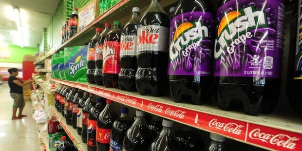 An approved tax would mean a major defeat for the soda industry, which has spent millions to crush the effort across America. Photo / AFP