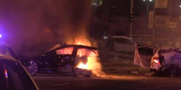 The scene of the crash in which a Tesla Model S split in half and burst into flames.