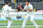 Trent Boult celebrates with Kane Williamson after his stunning catch to dismiss Danesh Ramdin during the summer. Photo /Getty Images