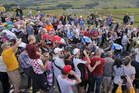 Fans get close to the riders during the second stage of the Tour de France in England. Photo / AP