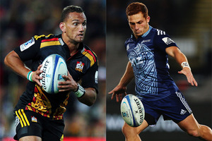 Aaron Cruden of the Chiefs and Ihaia West of the Blues rugby team. Photos / Getty Images