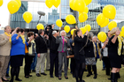 Family and friends of Alison Baden-Clay release yellow balloons, Alison's favourite colour, outside of the Supreme Court in Brisbane. Photo / AAP
