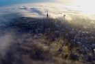 Auckland City centre is covered in a thick blanket of fog yesterday morning. Photo / Omnicron Productions