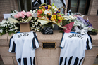 Tributes left to John Alder and Liam Sweeney, victims of the Malaysia Airlines crash by fellow Newcastle fans. Photo / Getty