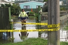 Kawakawa deputy chief fire officer Annette Wynyard wades through floodwaters at a Pembroke St home. Photo/Peter de Graaf