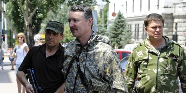 Commander and self-proclaimed minister of Defence Igor Girkin, centre, walks with his bodyguards in the eastern Ukrainian city of Donetsk. Photo / AFP