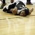 The San Antonio Spurs' Darius Morris writhes on the court after injuring a knee against the New Orleans Pelicans during the first half of an NBA summer league basketball game. Photo / AP