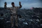 A man gestures at the crash site near the village of Grabovo, Ukraine. Photo / AP