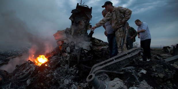 People inspect the crash site of the passenger plane near the village of Hrabove, Ukraine. Photo / AP