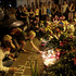 People hold candles and place flower tribute outside the Dutch embassy to commemorate victims of Malaysia Airlines plane crash in Kiev, Ukraine. Photo / AP