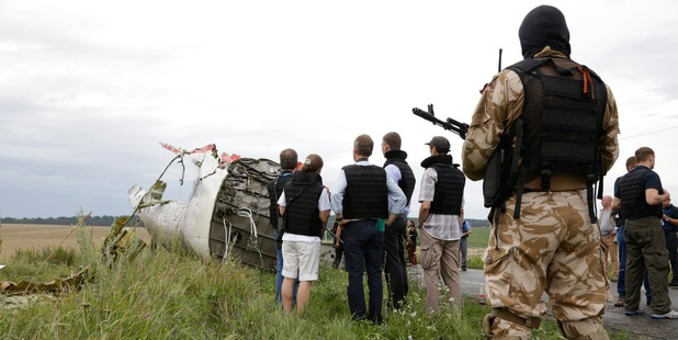 Representatives from the Organisation for Security and Cooperation and Ukrainian experts arrive at the crash site. Photo / AP