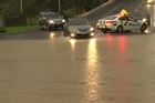 Torrential rain caused flooding and closed roads in Auckland and Waiheke this afternoon, with a number of people having to be rescued from rising floodwaters. The Fire Service responded to three people trapped in floodwaters on Clevedon-Kawakawa Bay Road, but all have been reported safe and well, Auckland Civil Defence said.