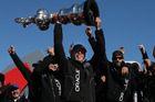Oracle boss Larry Ellison holds aloft the America's Cup. Photo / Getty Images