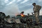 Debris at the crash site near the village of Grabovo, Ukraine. Photo / AP