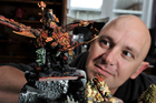 Damian McFetridge is a dedicated Warhammer   fan and often  holds games in his garage with other followers.Photo/George Novak