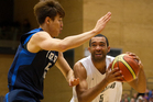 New Zealands, Everard Bartlett, tries to keep the ball from South Korea player, Jong Kyu Kim, during the basketball test match between the New Zealand Tall Blacks and South Korea played at the ASB Are