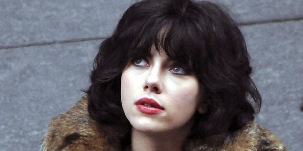 Johansson is in disguise, with a British accent and raven hair in Under the Skin.