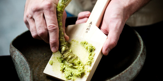Fresh wasabi root grated on a shark fin paddle at Masu. Photo / Babiche Martens