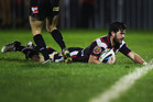 Chad Townsend of the Warriors dives over to score a try during the round 18 NRL match against the Parramatta Eels. Photo / Getty Images