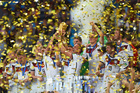 Germany celebrate with the World Cup trophy after defeating Argentina. Photo / Matthias Hangst / Getty Images