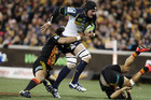 Ben Mowen of the Brumbies is tackled during the Super Rugby Qualifying FInal match between the Brumbies and the Chiefs at GIO Stadium. Photo / Getty Images.