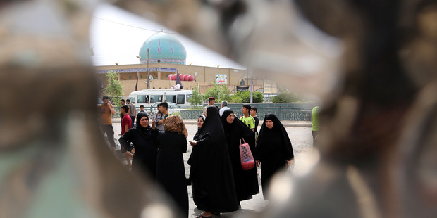 Iraqi women gather the morning after a car bomb explosion in Baghdad's eastern Ur neighborhood, Iraq. Photo / AP