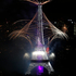 Bastille Day fireworks explode over the Seine river next to the Eiffel Tower in Paris. Photo / AP