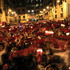 """Revelers sing ''Pobre de Mi,"""" a song which is sang at the end of the famous San Fermin festival, in Pamplona. Photo / AP"""
