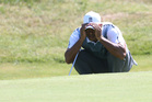 Tiger Woods of the US looks at his putt on the 9th green during the first day of the British Open Golf championship at the Royal Liverpool golf club. Photo / AP