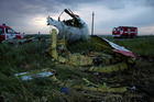 Fire engines arrive at the crash site near the village of Hrabove, Ukraine. Photo / AP