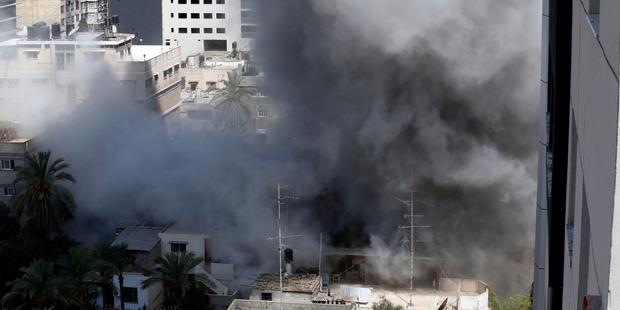 Smoke rises after an Israeli missile strike in Gaza City. Photo / AP