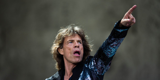 Mick Jagger says he threw himself into the band's European tour to cope with the death of his partner, L'Wren Scott.