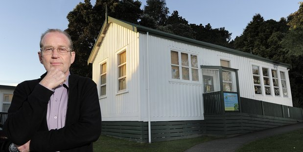 School principal Geoff Opie in front of the 116-year-old classroom.