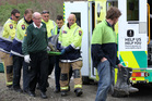 Emergency services carry one of the riders in the motorbike crash on Saturday to the ambulance. Photo/Duncan Brown