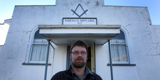 Julian Baier is the new Master of the Waihenga St John's Masonic Lodge. The Masons' international symbol can be seen above the sign. Photo/Lynda Feringa