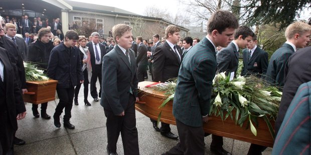 The coffins of Sam and Angus Donald are carried from the Rathkeale College auditorium. Parents Tracie and David Donald are at centre and brother Bayley Donald was a pall bearer. PHOTO/LYNDA FERINGA