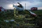 Fire engines arrive at the crash site near the village of Hrabove, Ukraine. Photo / AP