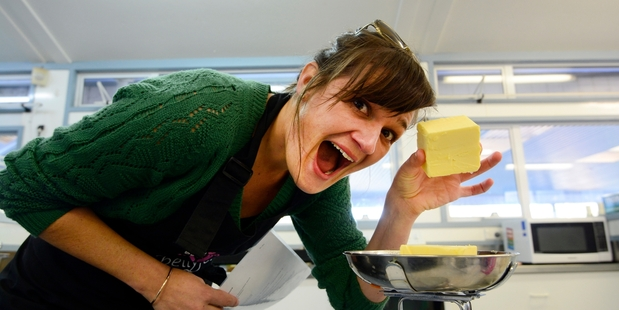 Ruth Keber measures out the butter for her roux when volunteering for Bellyful as part of Bay of Plenty Times Gives Back. PHOTOS/GEORGE NOVAK
