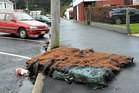 A burnt mattress lies in Howe St in Dunedin yesterday afternoon. Photo / Peter McIntosh.