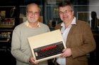 Dave Jaggar (right) holds the computer he revolutionised after his university thesis was given top marks by Professor Emeritus Bob Doran. Photo / Sarah Ivey