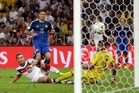 Germany's Mario Gotze slots in the winning goal past Argentina's goalkeeper, Sergio Romero.  Photo / AP