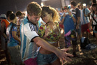 A woman from Brazil and a man from Argentina dance samba on Copacabana beach. Photo / AP
