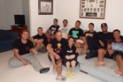 Spencer and Carmen Taplin (middle) surrounded in their Sydney home by the New Zealand Roosters contingent (from left) Jared Waerea-Hargreaves, Joseph Manu, Reuben Porter, Arthur Currie, Isaac Crichton, Roger Tuivasa-Sheck, Frank-Paul Nuuausala and Chevi Ellis.