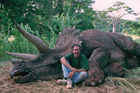Steven Spielberg poses with a 'dead' Triceratops.