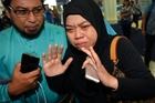 Relatives of passengers who were on Malaysian Airlines Flight 17 gather at Kuala Lumpur International Airport. Photo / AP