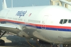Malaysia Airlines flight MH17 photographed by passenger Cor Pan while  being refuelled  at Schiphol  Airport, Amsterdam.