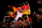 German fans on Rio's Copacabana beach celebrate their team's victory. Photo / AP