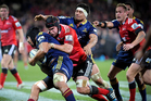Nasi Manu of the Highlanders is tackled by Matt Todd of the Crusaders. Photo / Getty Images