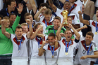 Germany's team captain Philipp Lahm lifts the World Cup trophy. Photo / AP